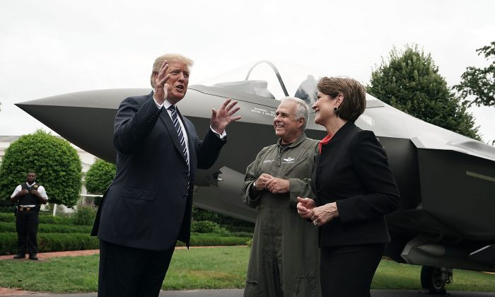 U.S. President Donald Trump (L) talks to Chairman, President and CEO of Lockheed Martin Marillyn Hewson (R) and Director and Chief Test Pilot Alan Norman (2nd L) in front of an F-35 fighter jet during the 2018 Made in America Product Showcase at the White House in Washington, DC. on July 23, 2018. (Alex Wong/Getty Images)