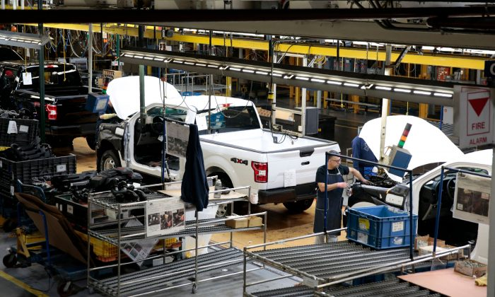 An employee works on the assembly line for the Ford 2018 and 2019 F-150 truck at the Ford Motor Company's Rouge Complex in Dearborn, Mich., on Sept. 27, 2018. (JEFF KOWALSKY/AFP/Getty Images)