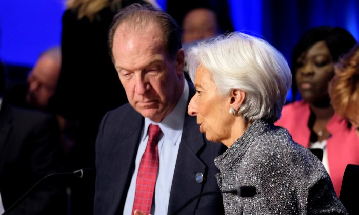 World Bank Group President David Malpass and IMF Managing Director Christine Lagarde at the IMF and World Bank's 2019 Annual Spring Meetings, in Washington, D.C. on April 13, 2019. (James Lawler Duggan/Reuters)