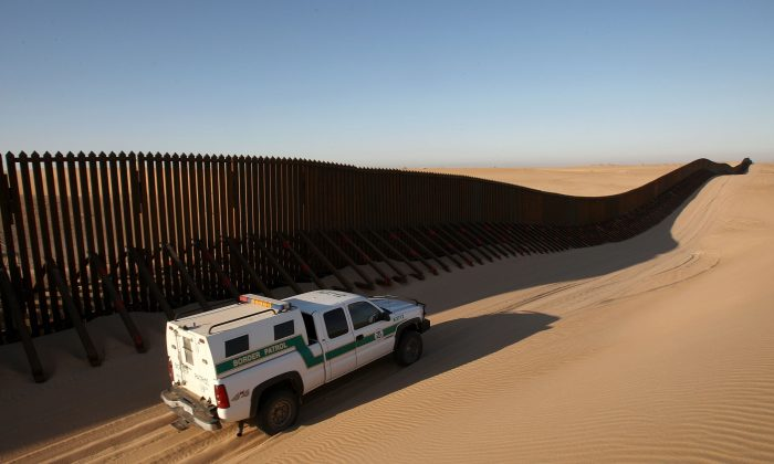 A border patrol vehicle patrols along a recently constructed section of the border fence expansion between Yuma, Ariz., and Calexico, Calif., on March 14, 2009. (David McNew/Getty Images)