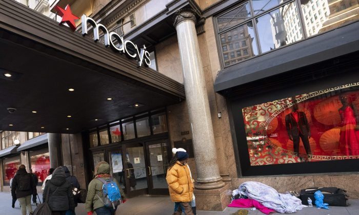 Pedestrians regard a homeless person sleeping outside the Macy's store at Manhattan's Herald Square in New York, on Jan. 11, 2019. (Don Emmert/AFP/Getty Images)