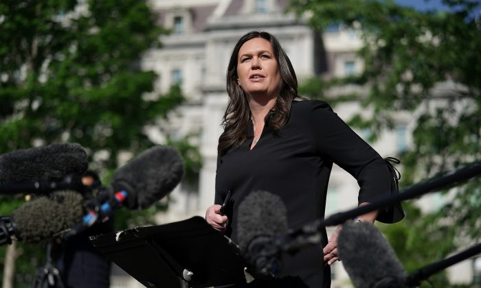 White House press secretary Sarah Huckabee Sanders talks to reporters after being interviewed on FOX News outside the White House April 29, 2019. (Chip Somodevilla/Getty Images)