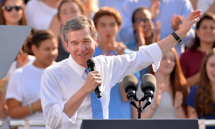 Democratic Governor nominee Roy Cooper campaigns during an event for Democratic presidential nominee Hillary Clinton on the campus of the University of Chapel Hill on November 2, 2016 in Chapel Hill, North Carolina.  Sara D. Davis/Getty Images