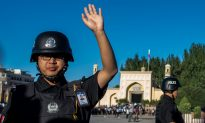 Police Surveillance App in Xinjiang Targets 36 Types of 'Problematic' People, Report Says