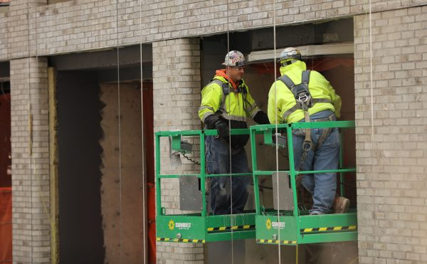 Construction workers are seen at a building site in New York City