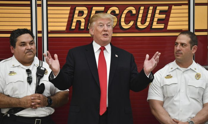 President Trump speaks to first responders at West Palm beach Fire rescue in West Palm Beach, Fla., on Dec. 27, 2017. (Nicholas Kamm/AFP/Getty Images)
