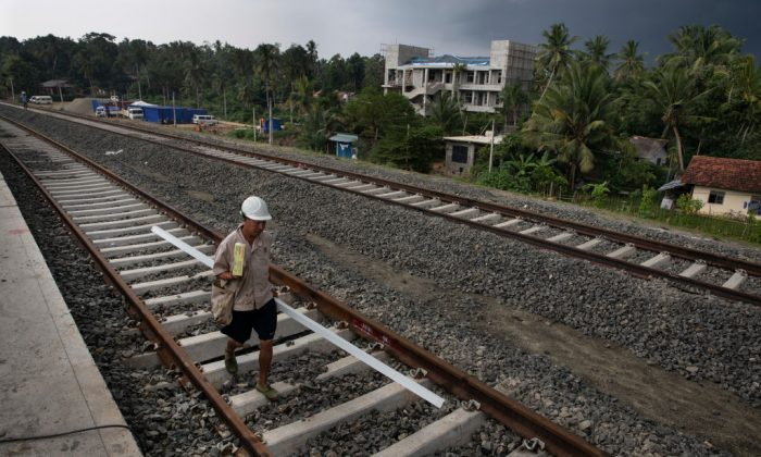 Chinese workers help to build a new train station in Beliatta, Sri Lanka which is Chinese managed and designed on Nov. 18, 2018 (Paula Bronstein/Getty Images)