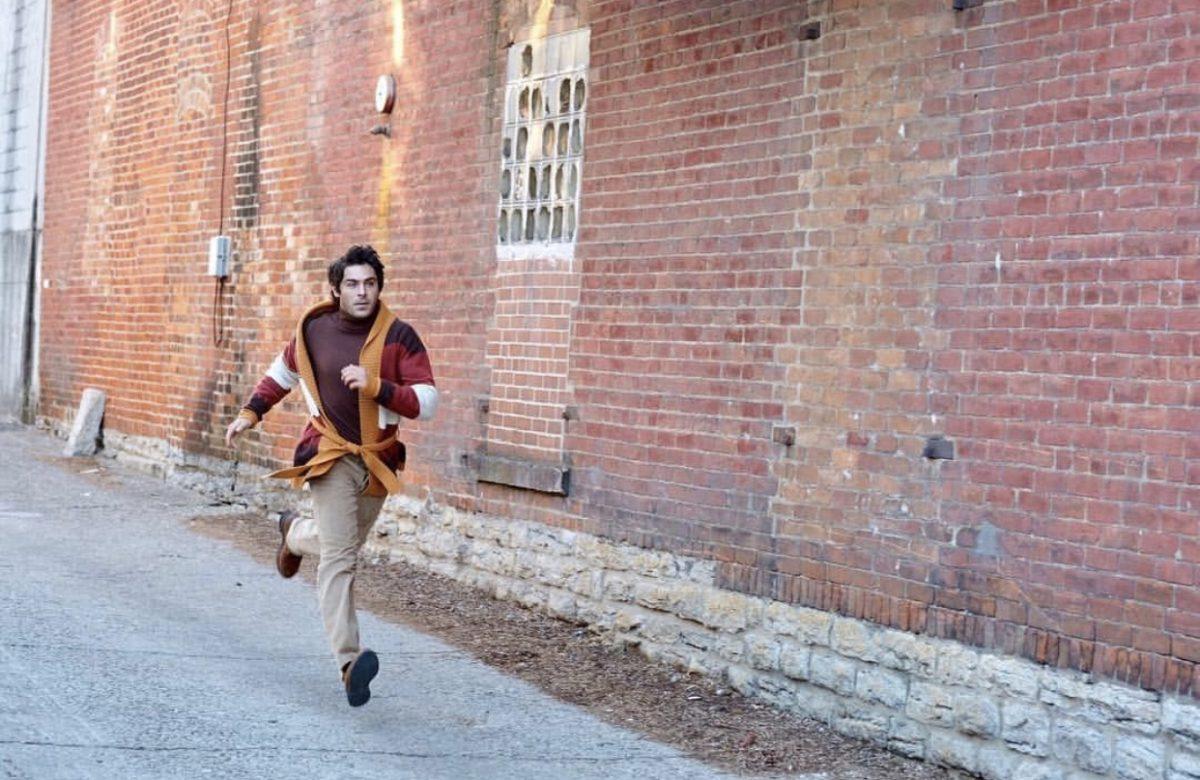 man running down alley