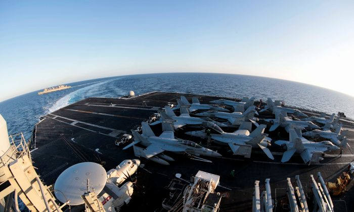 The Nimitz-class aircraft carrier USS Abraham Lincoln (CVN 72) breaks away from the fast combat support ship USNS Arctic (T-AOE 8) after an underway replenishment-at-sea in the Mediterranean Sea in this April 29, 2019 photo supplied by the U.S. Navy. (U.S. Navy/Mass Communication Specialist 3rd Class Garrett LaBarge/Handout via REUTERS)