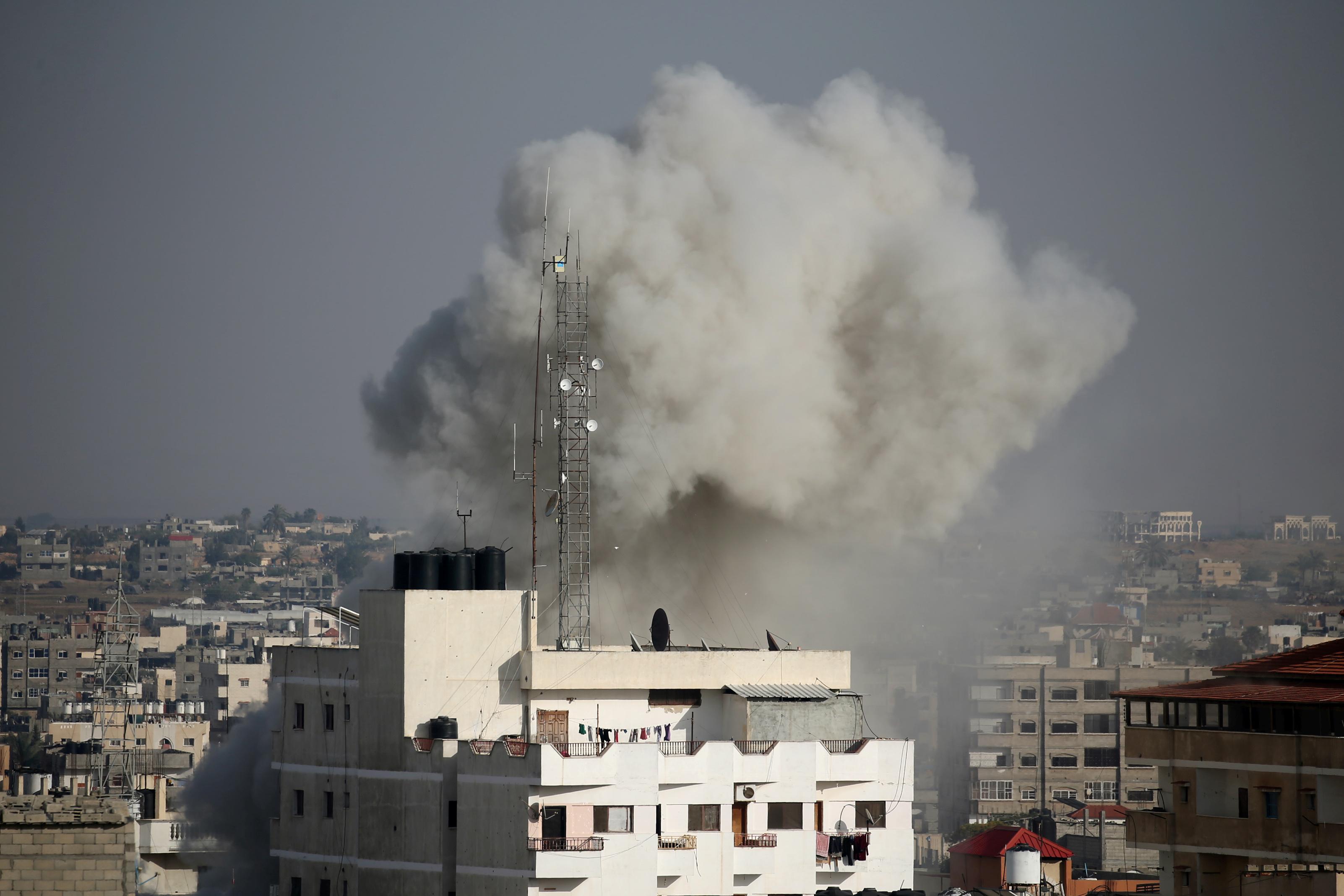 Smoke rises during an Israeli air strike in the southern Gaza Strip