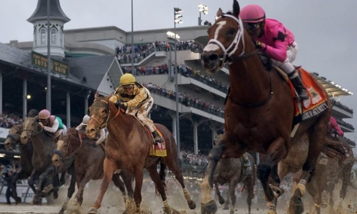 Luis Saez rides Maximum Security, right, across the finish line first against Flavien Prat on Country House during the 145th running of the Kentucky Derby horse race at Churchill Downs Saturday in Louisville, Ky., on May 4, 2019. (Matt Slocum/AP Photo)