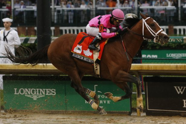 Maximum Security #7, ridden by jockey Luis Saez crosses the finish line during 145th running of the Kentucky Derby