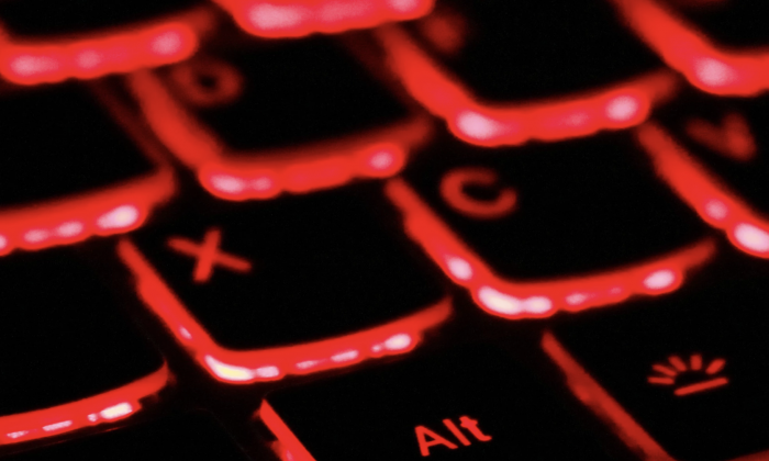 Close-up of keys on red backlit keyboard. (Unsplash)