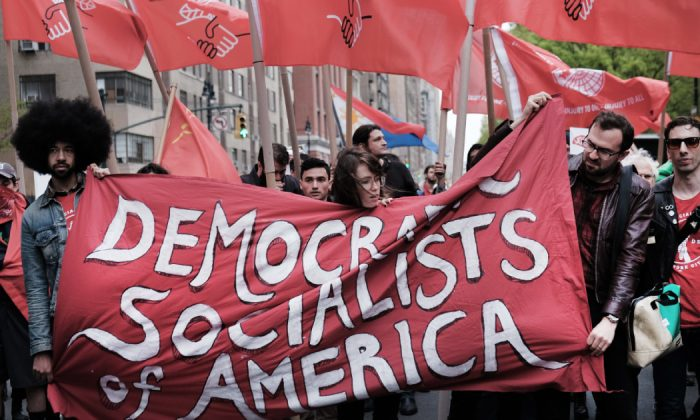 Members of the Democratic Socialists of America gather outside of a Trump owned building on May Day in New York City on May 01, 2019. (Spencer Platt/Getty Images)
