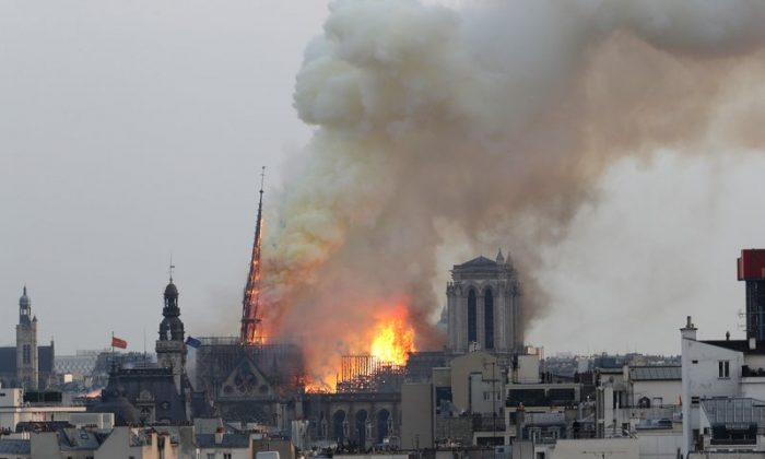 Notre Dame cathedral as it burns in Paris. Notre Dame Cathedral's melted roof has left astronomically high lead levels in the plaza outside and adjacent roads. Paris police say lead levels from the roof were found to be between 10 and 20 grams per kilogram of ground — between 32 and 65 times the recommended limit by French health authorities of 0.3 grams per kilogram. On April 15, 2019. (AP Photo/Thibault Camus)