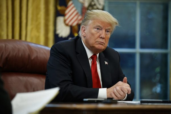 President Donald Trump listens
