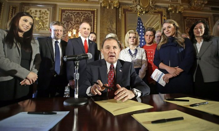 Utah Gov. Gary Herbert looks up during a ceremonial signing of a state resolution declaring pornography a public health crisis, at the Utah State Capitol, in Salt Lake City, on April 19, 2016. (Rick Bowmer/AP Photo)