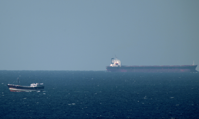 An oil tanker cruises towards the Strait of Hormuz off the shores of Khasab in Oman on Jan. 15, 2011. (Marwan Naamani/AFP/Getty Images)