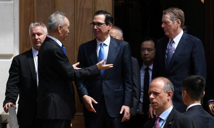 Chinese Vice Premier Liu He talks with U.S. Treasury Secretary Steven Mnuchin and Trade Representative Robert Lighthizer as he leaves trade talks in Washington, U.S., May 10, 2019. REUTERS/Leah Millis