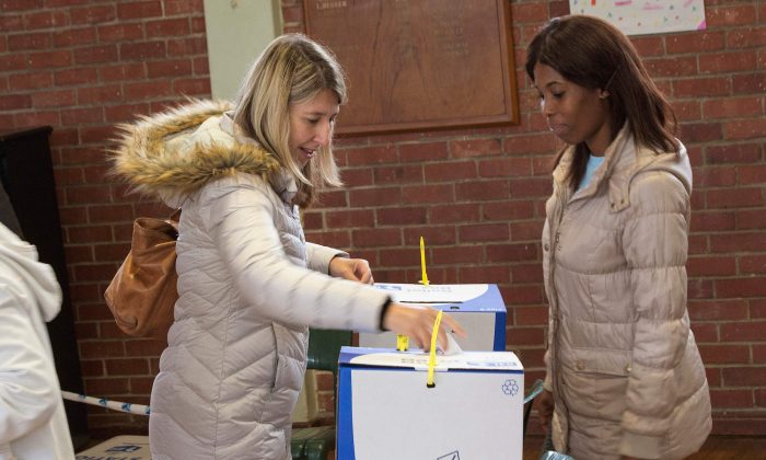 A woman casts her vote in Claremont, a middle-class suburb, during South Africa's national and provincial elections in Cape Town on May 8, 2019. (Rodger Bosch/AFP/Getty Images)