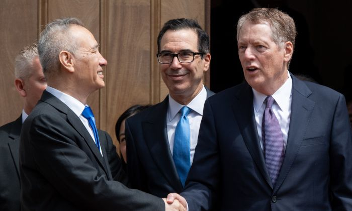 Chinese Vice Premier Liu He (L) shakes hands with US Trade Representative Robert Lighthizer (R) alongside US Treasury Secretary Steven Mnuchin (C) after trade negotiations in Washington, DC, on May 10, 2019. (Saul Loeb/AFP/Getty Images)
