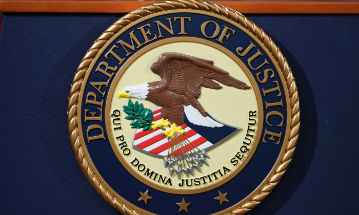 The U.S. Department of Justice seal is seen on a lectern ahead of a press conference at the Department of Justice building in Washington, DC on November 28, 2018. (MANDEL NGAN/AFP/Getty Images)