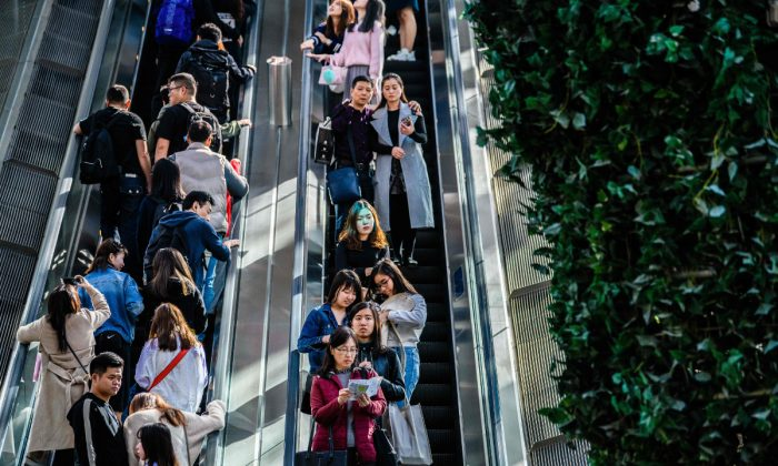 People on an escalator. (Anthony Wallace/AFP/Getty Images)