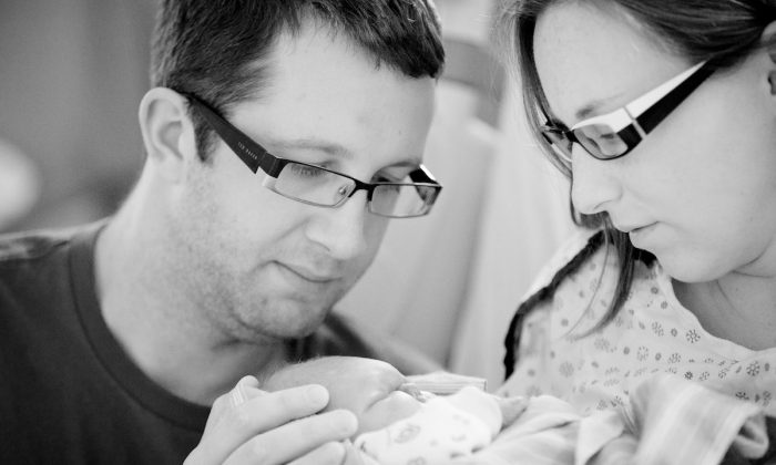 Aaron (L) and Alexis Chute with Zachary after his birth. (C U Photography)