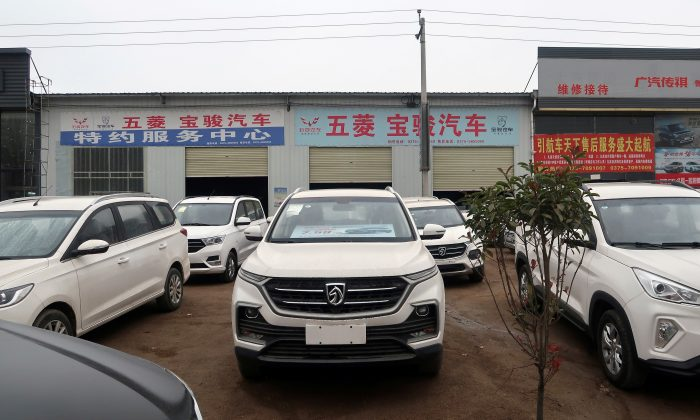 Baojun cars wait for sale in front of a dealership in Lushan County, Henan Province, China on Nov. 16, 2018. (Yilei Sun/Reuters)