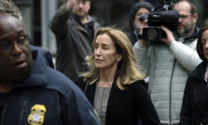 Felicity Huffman arrives at federal court in Boston, where she is scheduled to plead guilty to charges in a nationwide college admissions bribery scandal, on May 13, 2019. (Steven Senne/AP Photo)