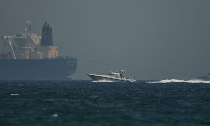 An Emirati coast guard vessel passes an oil tanker off the coast of Fujairah, United Arab Emirates,on May 13, 2019. (Jon Gambrell/AP Photo)