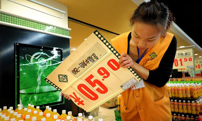 A Chinese worker changes a food price board at a supermarket in Hefei, east China's Anhui province on Nov. 17, 2010. (STR/AFP/Getty Images)