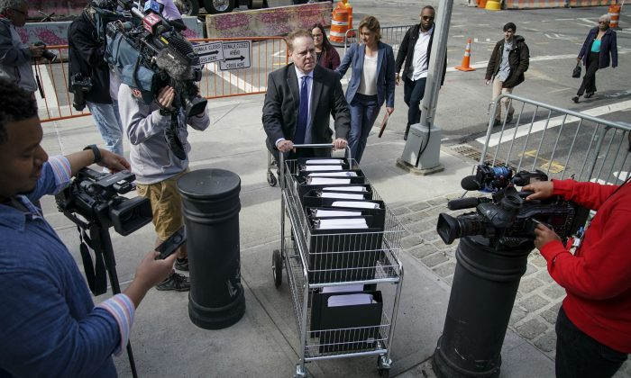 John Marzulli, public information officer for the U.S. Attorneys Office of the Eastern District of New York, pushes a cart full of court documents on the U.S. v. Keith Raniere case at the U.S. District Court for the Eastern District of New York  in the Brooklyn borough of New York City on May 7, 2019. (Drew Angerer/Getty Images)