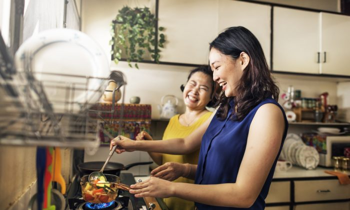 Some of the loveliest moments can come from two people working side by side in the kitchen. (Shutterstock)