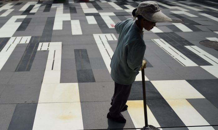 A woman cleaning (Greg Baker/AFP/Getty Images)