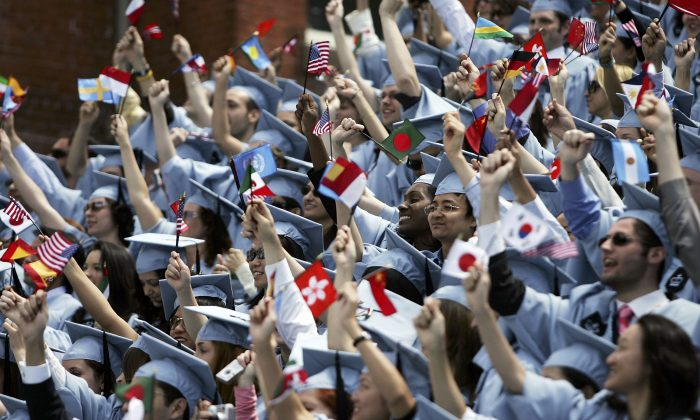 Students cheer during commencement ceremonies at Columbia University May 18, 2005 in New York City. This is the 251st class to graduate from Columbia. Spencer Platt/Getty Images