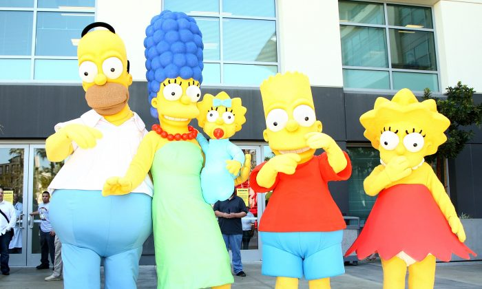 """The Simpsons"" characters pose for a postage stamp dedication ceremony in Los Angeles, Calif., on May 7, 2009. (Alberto E. Rodriguez/Getty Images)"