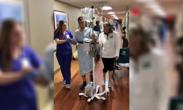 Survivor Drew Pescaro walks for the first time since the University of North Carolina Charlotte shooting at a hospital in North Carolina on May 13, 2019. (Drew Pescaro/Twitter)
