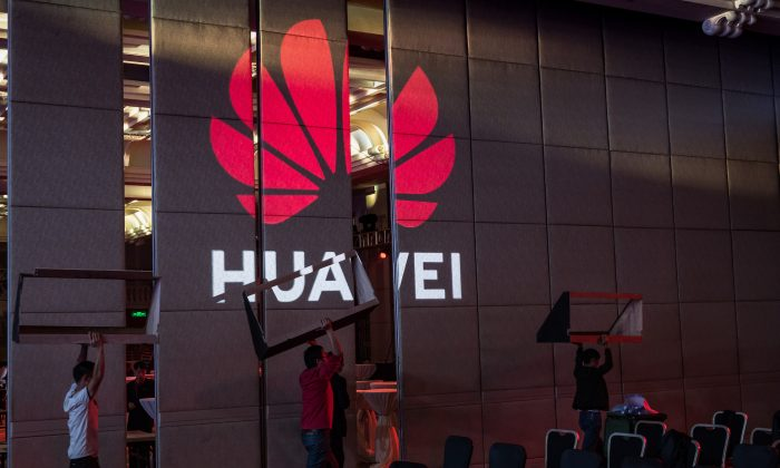 Workers prepare the venue for a Huawei summit in Shenzhen, China, on April 16, 2019. (Billy H.C. Kwok/Getty Images)
