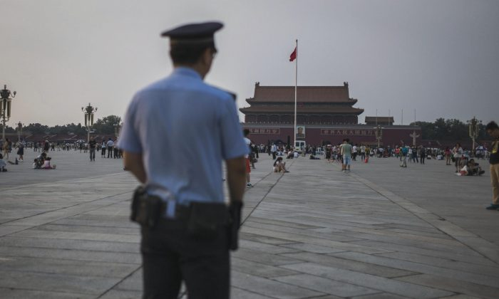A Chinese policeman patrols as tourists gather in Tiananmen Square in Beijing on June 4, 2016, on the 27th anniversary of the June 4, 1989 crackdown on pro-democracy protests. (Fred Dufour/AFP/Getty Images)