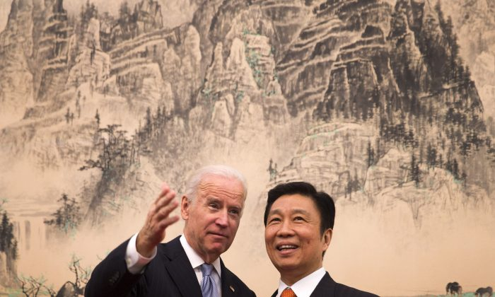 Then-Vice President Joe Biden (L) chats with Chinese Vice Chair Li Yuanchao in Beijing on Dec. 5, 2013. (Andy Wong-Pool/Getty Images)