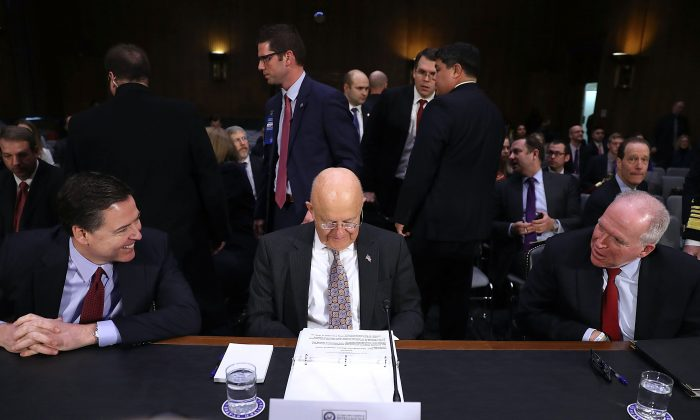 (L-R) FBI Director James Comey, Director of National Intelligence James Clapper and Central Intelligence Agency Director John Brennan wait to testify before the Senate Intelligence Committee on Jan. 10, 2017. (Joe Raedle/Getty Images)