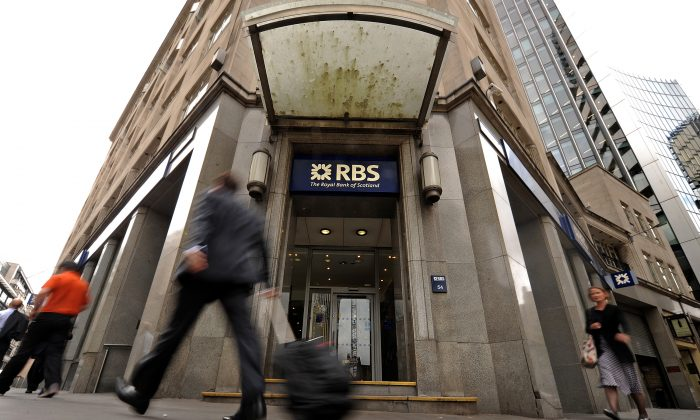 People walk past a branch of the Royal Bank of Scotland (RBS),in London, on Aug. 4, 2010. (Ben Stansall/AFP/Getty Images)
