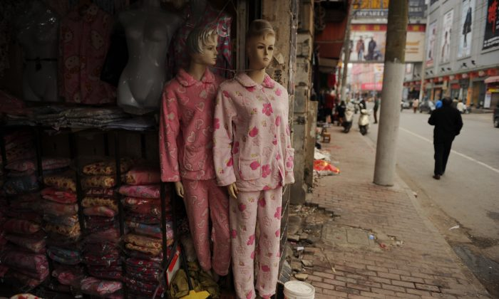 A man walks outside a wholesale clothing market in Shanghai, China on Feb. 25, 2013. (Peter Parks/AFP/Getty Images)