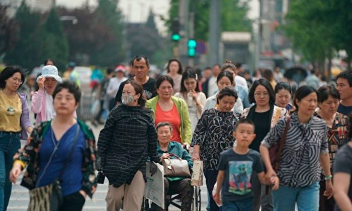 "People cross a street in Beijing on May 10, 2019. Western pundits have been promoting a so-called ""Chinese Century,"" which may never happen. (Fred Dufour/AFP/Getty Images)"