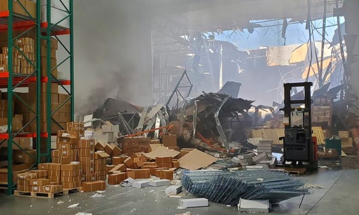 An F-16 fighter jet crashed into a warehouse just off March Air Reserve Base in Perris, Calif. on May 16, 2019. (Riverside County Sheriff's Office)