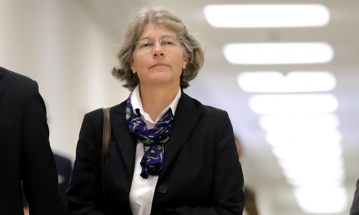 Fusion GPS contractor Nellie Ohr arrives for a closed-door interview with investigators from the House Judiciary and Oversight committees in the Rayburn House Office Building on Capitol Hill in Washington Oct. 19, 2018. (Chip Somodevilla/Getty Images)