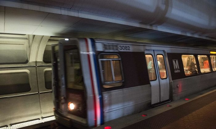 A Metro train enters the Farragut North station in Washington, on May 6, 2016. (Nicholas Kamm/AFP/Getty Images)