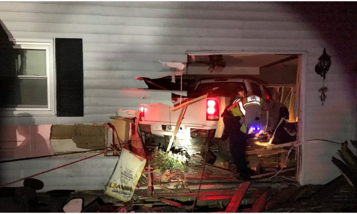 A GMC Pick up truck embedded in a house in Spring Grove, Lake County, Illinois. (Lake County Sheriff's Office)