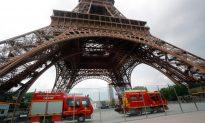 Eiffel Tower Evacuated as Man Seen Climbing the Landmark